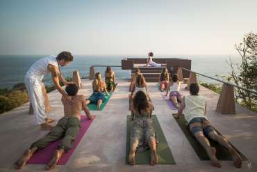 people in yoga cobra pose at Yoga Teacher Training Course 200hr in Mexico
