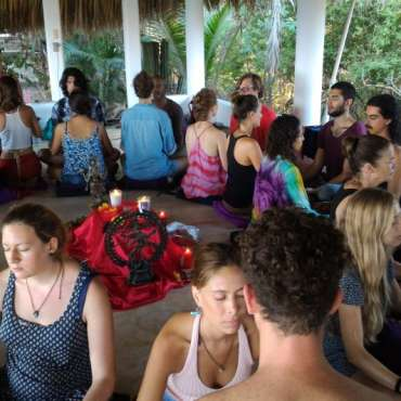 gathering of people sitting partnered up at Art of Tantra ritual