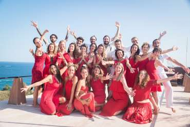 Tantra Teacher Training Course 200hr graduates smiling on rooftop with the pacific Mexican Ocean in the background