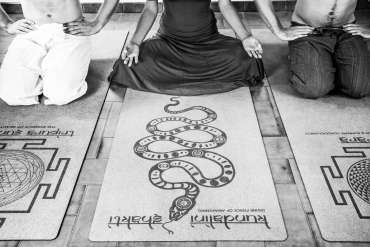 people sitting in meditative posture contemplating on what is tantra yoga