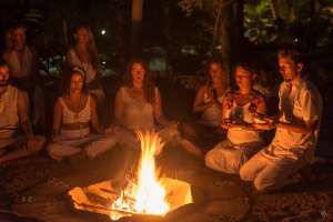 yoga ritual led by senior teachers by the fire