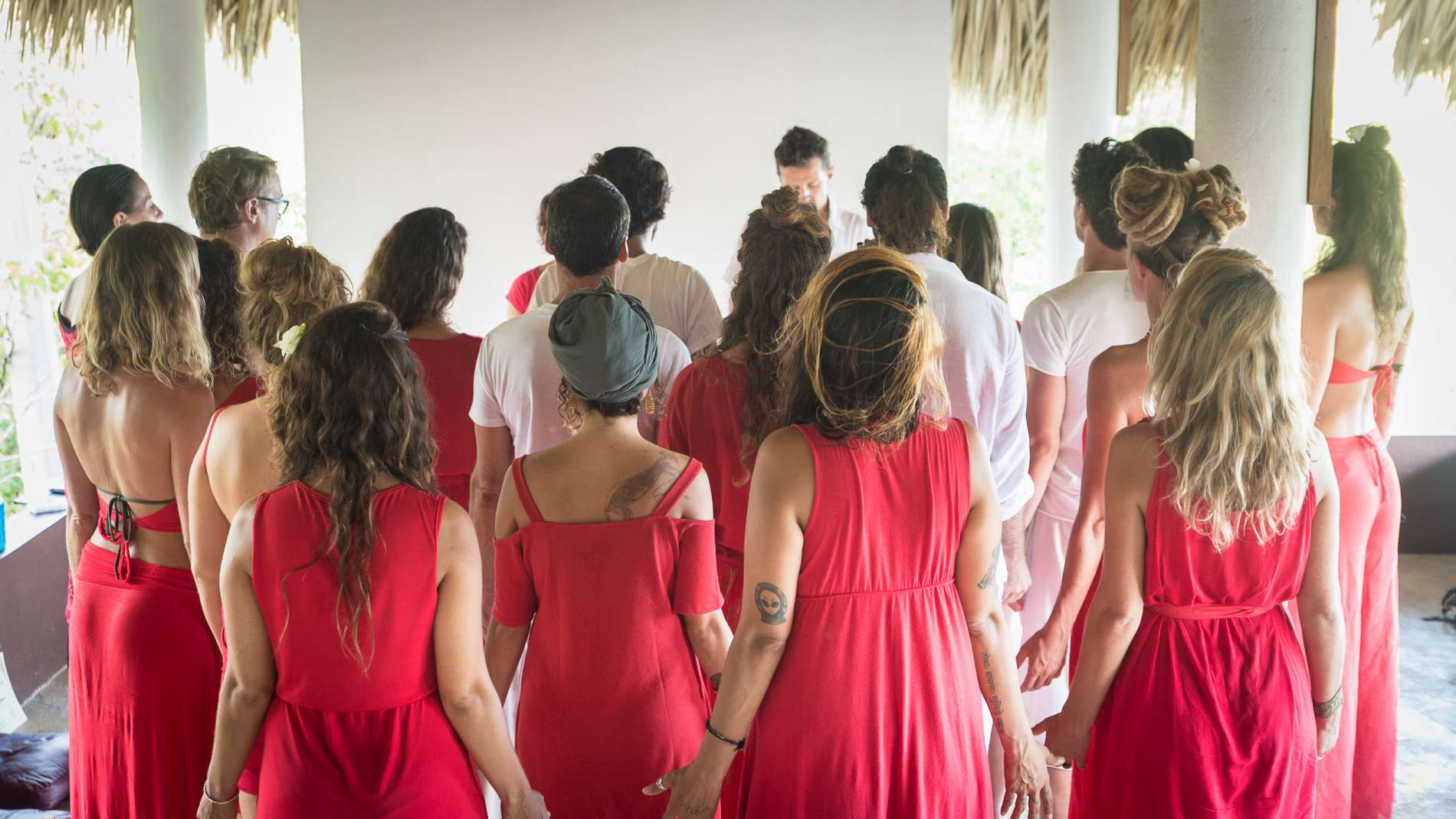 yoga teacher training group men and women together during a ritual
