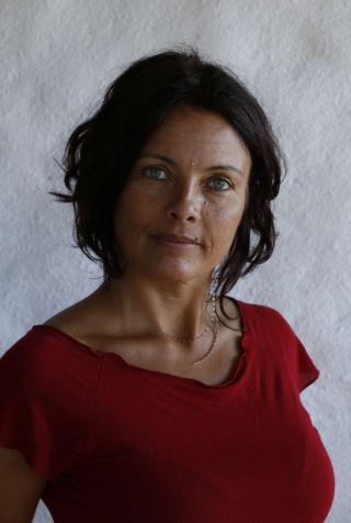 tantric webinar series senior yoga teacher Amita dressed in red