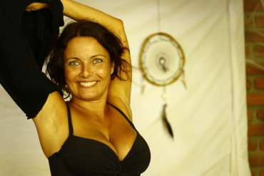 woman smiling and dancing during tantric online courses