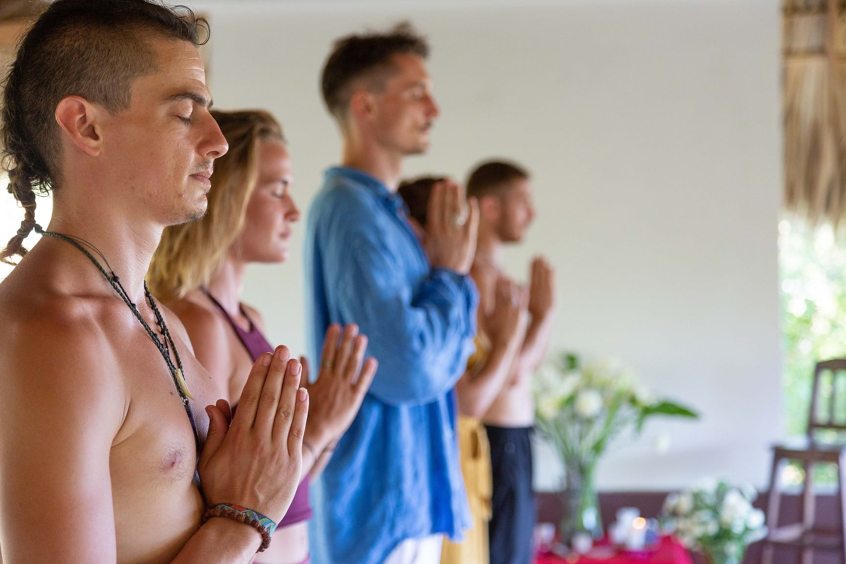 Closed eyes spiritual couples setting intentions for tantric practice