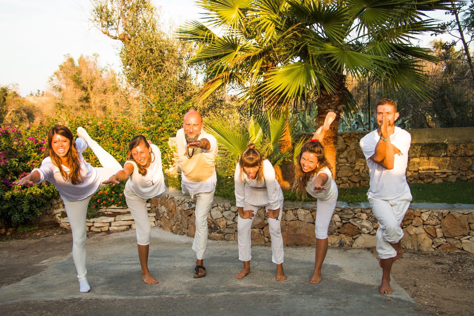 Yoga teacher training students doing various yoga asanas in a garden