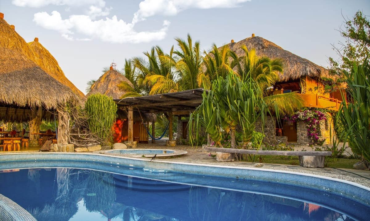 Heavenly yoga retreat center with huts and pool