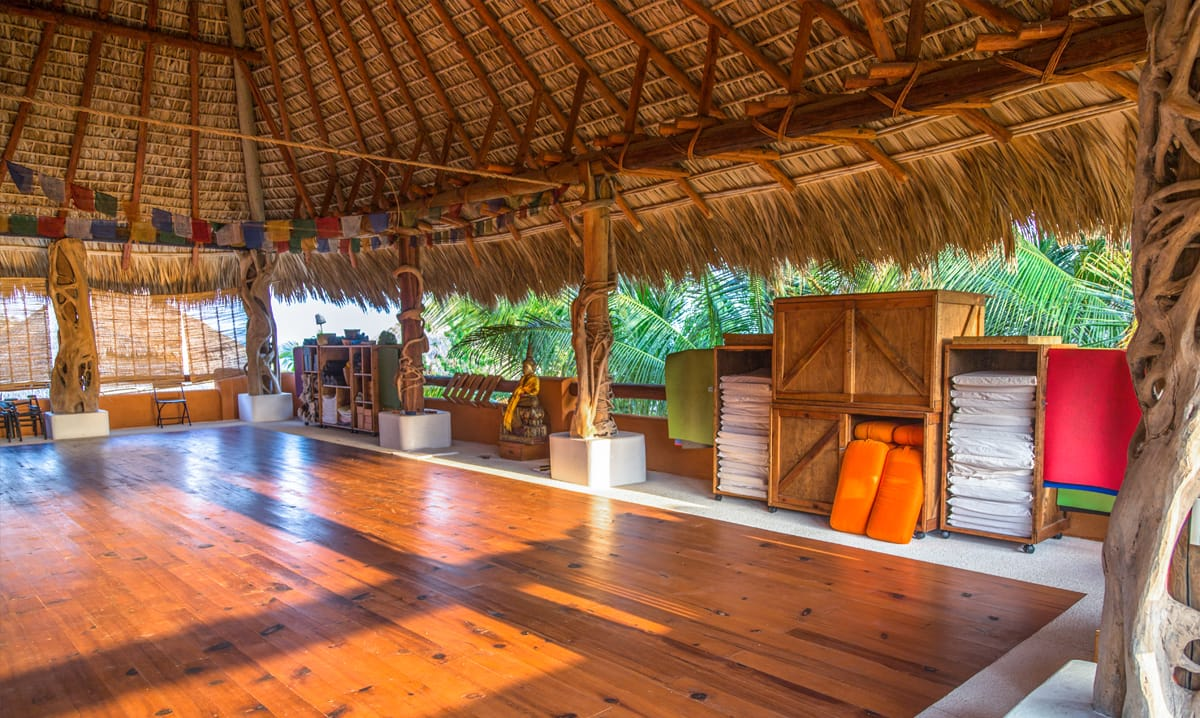 open air wooden yoga studio in retreat center