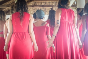 Tantra Yoga Students Wearing Red standing in a meditative position