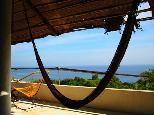 Chair and hammock in a terrace with amazing sea view